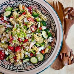 bright spring vegetables pasta crab and feta are tossed in a puckery ...