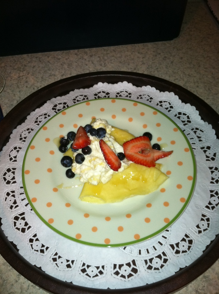 Morning crepes filled with honey sweetened ricotta and berries
