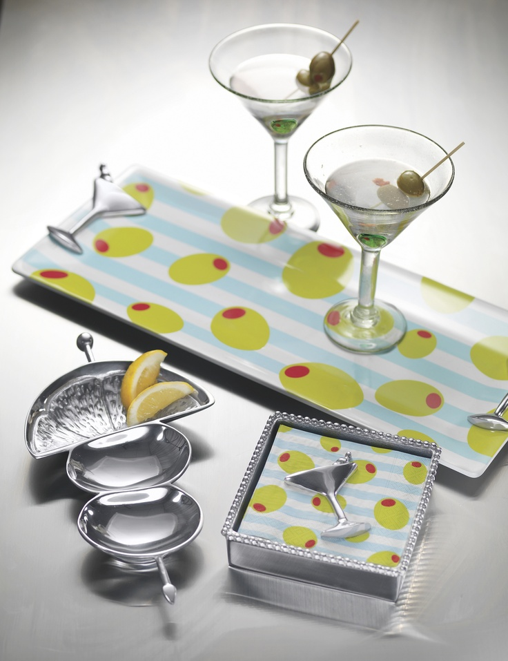 Mariposa Cocktail Party serving pieces and glassware are accented with ...