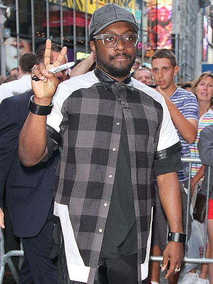 Will.i.am busted out a swanky pair of translucent, slate-gray specs as he signs autographs for fans