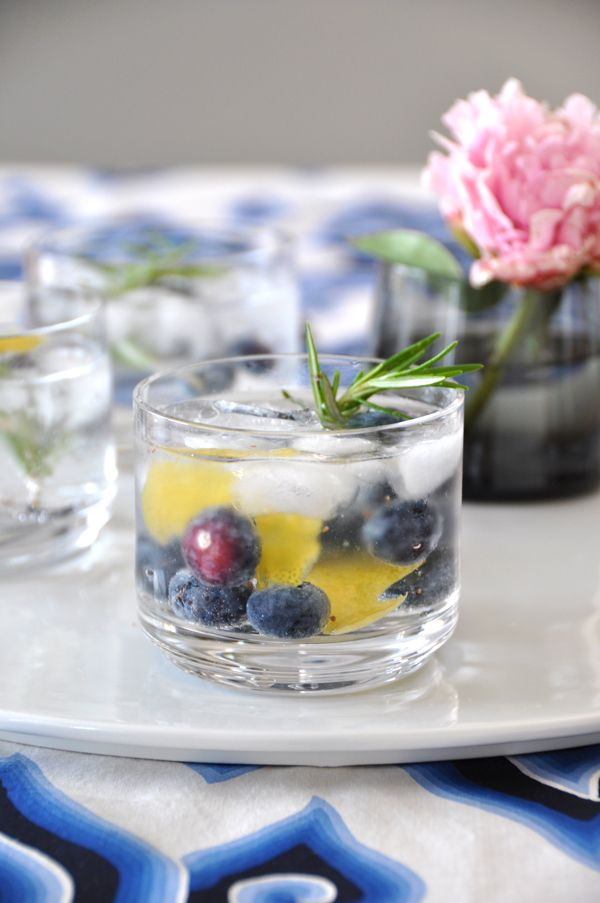 ... from lemon wedge 2 ounces gin mild flavored tonic rosemary stem ice