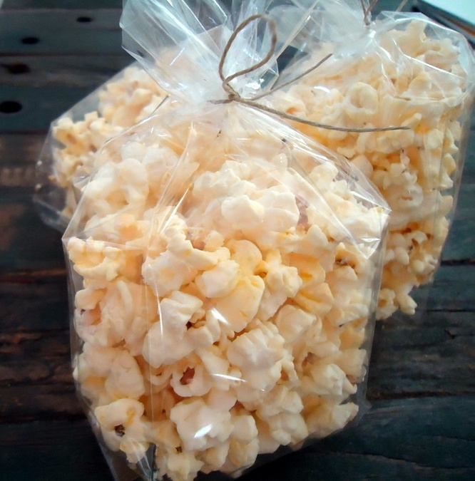 Choc-n-Pops: White chocolate covered popcorn  - Kids love this and it's great     for 'any' occasion. Try it cold - refrigerate it. Purchase 10 / 6 / 4 or 2 ounce bags for $10 / $7.50 / $5.00 or $2.50