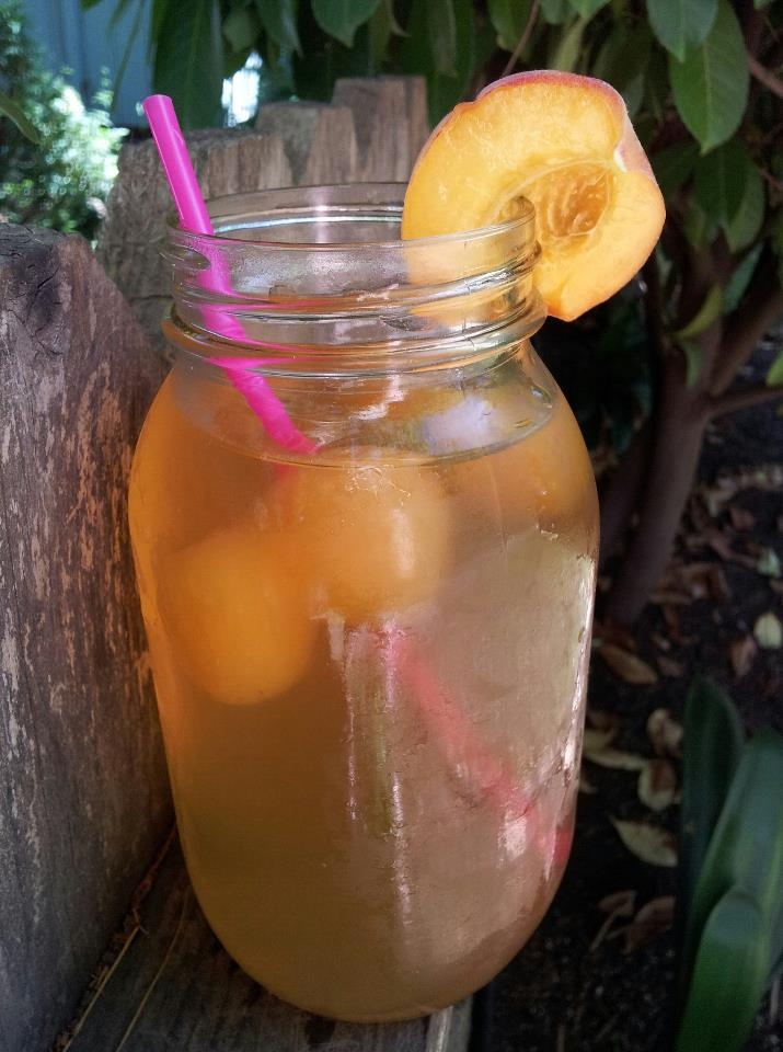 PEACH SUN TEA : (Because I really WANT to like green tea.) Mason jar + one Herbal Peach Tea Bag + 1 Green Tea Bag- Set out in sun for a few hours. Add ice cubes made from organic peach juice.