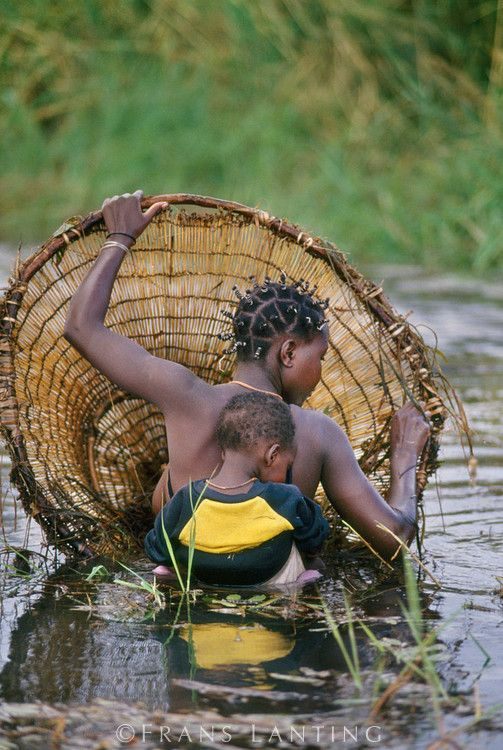 Hambukushu woman and child fishing, Okavango Delta, Botswana