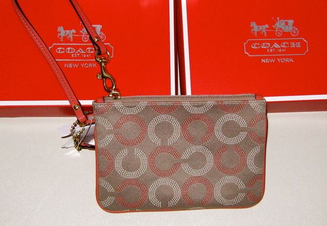 Nwt coach op art print sateen with leather strap is going up for