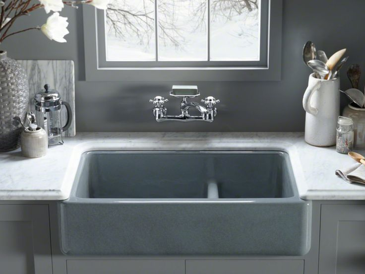 Kohler Whitehaven sink with tall apron.