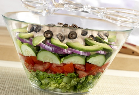 Layered Tex-Mex Salad. Lettuce, tomatoes, cucumber, red onion, avocado ...