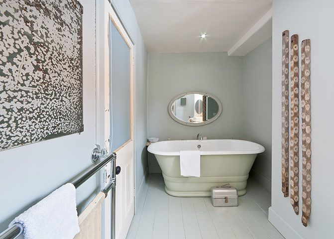 Bath is painted in Farrow and Ball Vert de Terre, the floor and walls in Light Blue
