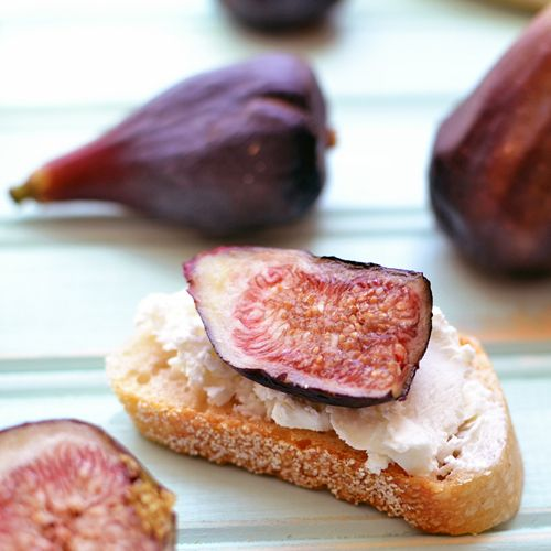 Fig & Goat Cheese Crostini   slice of fig atop a generous slather of ...