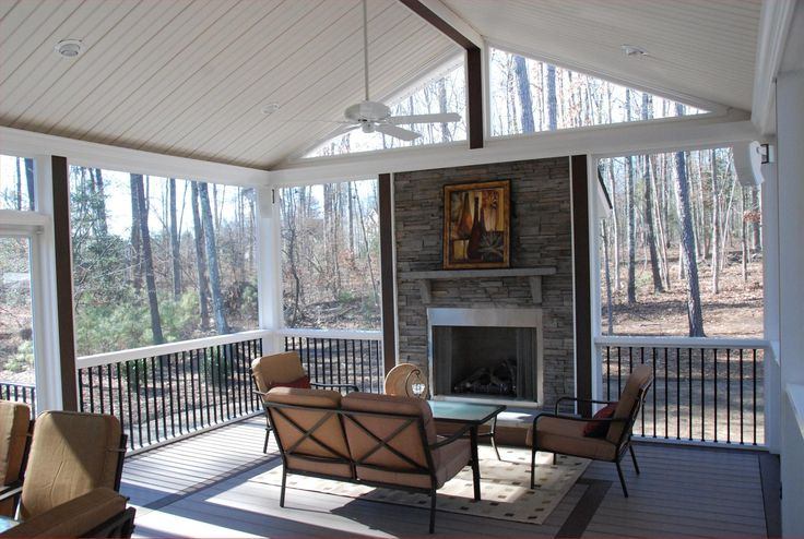 Rock fireplace on a screened in porch inspiring for Screened in porch fireplace ideas