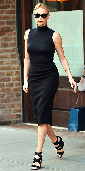CHARLIZE THERON  After swinging by the Today show, Charlize hits the N.Y.C. streets looking very Manhattan chic wearing head-to-toe black – a basic Dior dress, Donna Karan sandals and big shades.