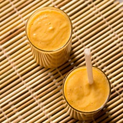 refreshing vegan lassi made with papaya and flavored with cardamom