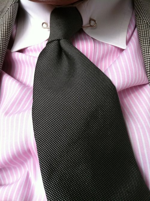 Pink Stripes Contract With A Dark Tie About A Man And