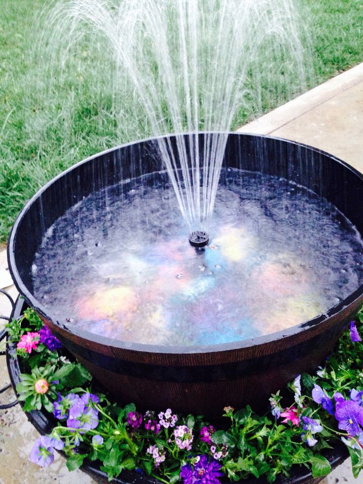 whiskey barrel fountain for my garden pinterest