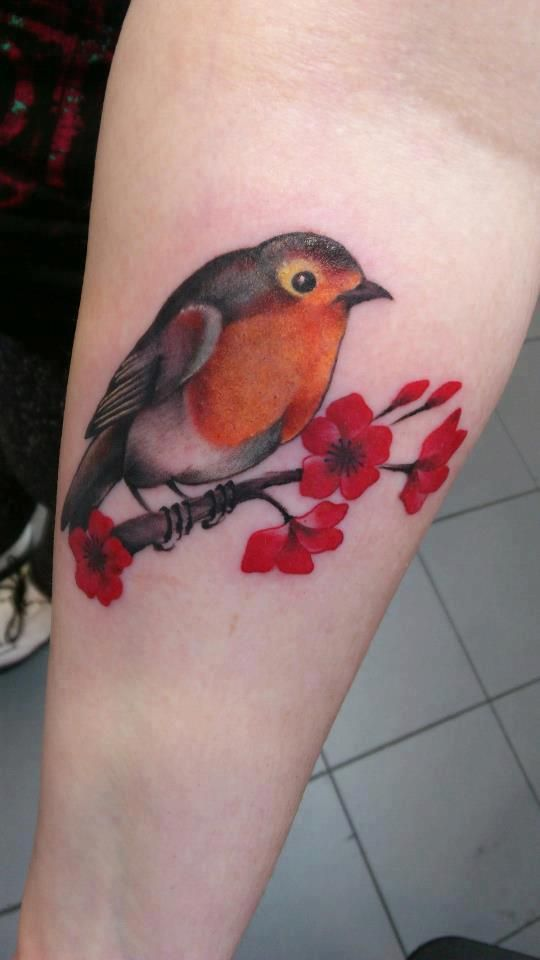 sweet robin tattoo with flowers.