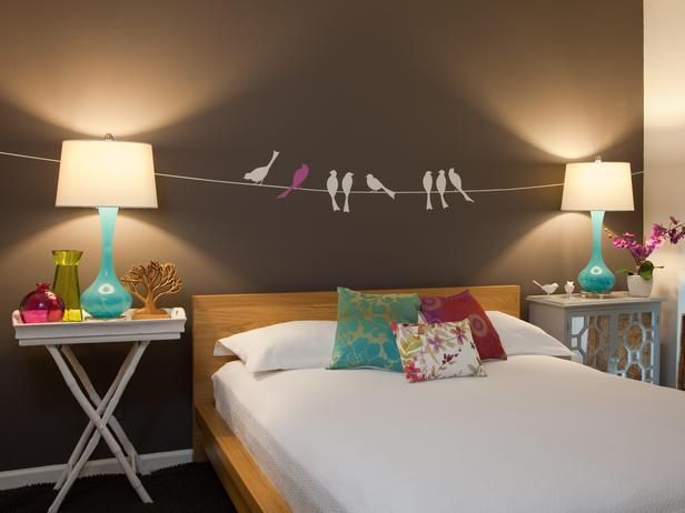 Rachel Kate's Design Portfolio : This fun, playful painting idea is a great solution for an empty wall space above a bed. All you need: painter's tape, paper to make few homemade stencils and a couple of tubes of acrylic paint.
