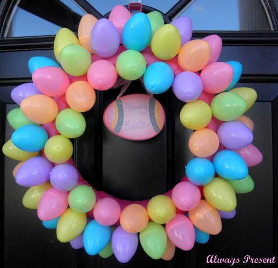 Bright & Colorful Spring Easter Egg Wreath - looks easy...wrap foam wreath with your choice ribbon then hot glue different color plastic eggs to the wreath then hang with ribbon.