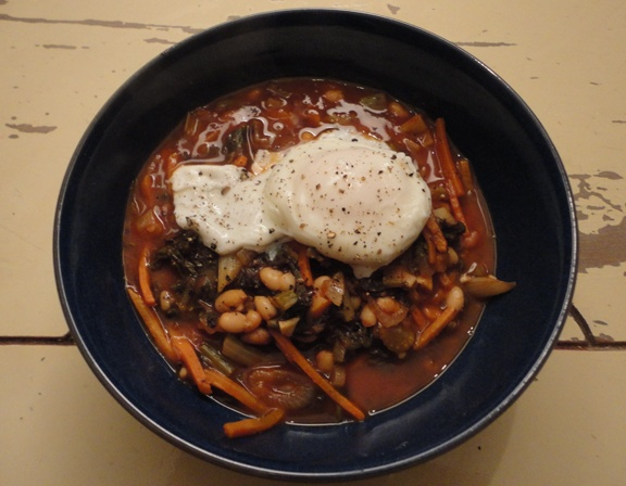 White bean and Swiss Chard stew...served with a poached egg on top