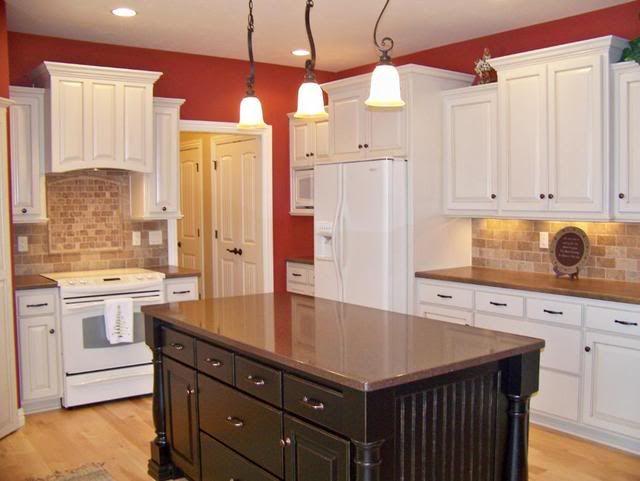Cream kitchen with espresso island, and bisque appliances