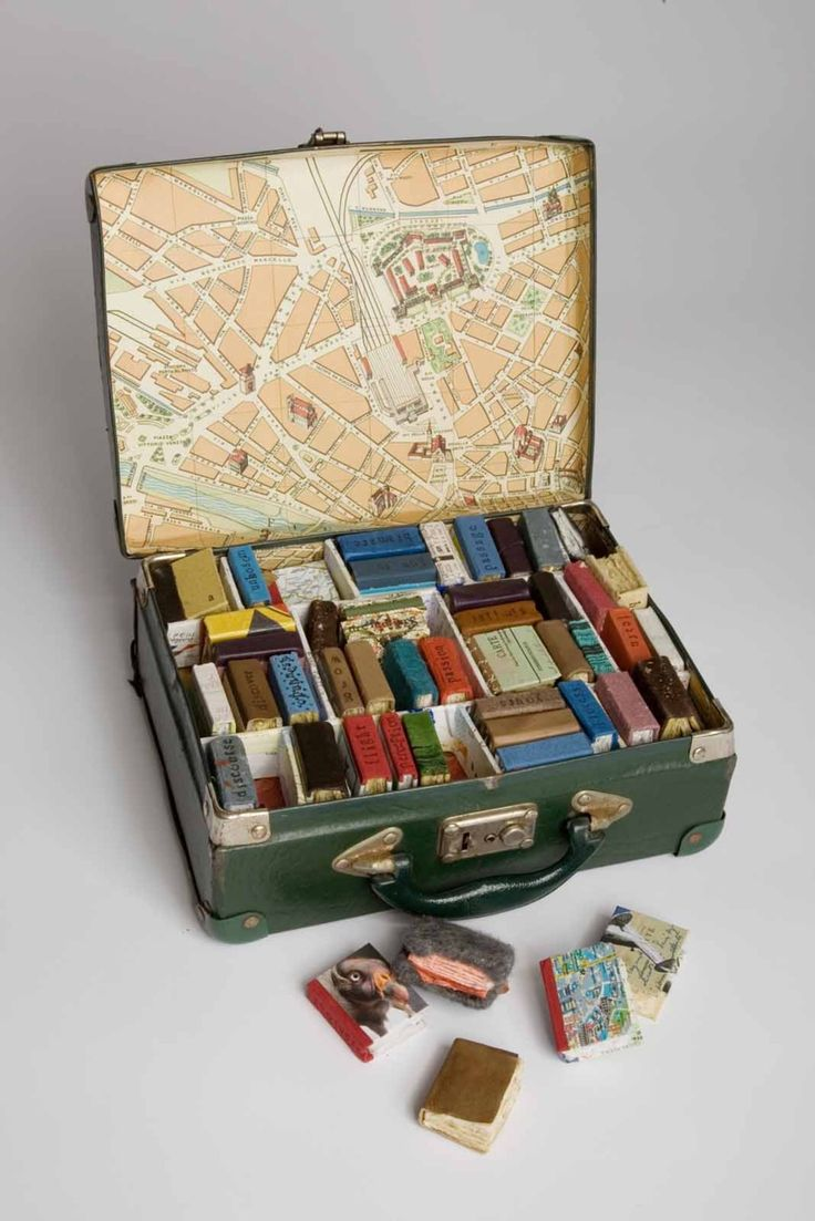 Tiny miniature books in a little suitcase