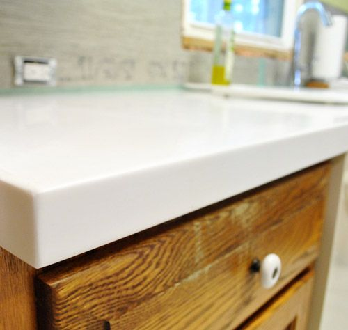 ... Petersik @ younghouselove has me sold on white Corian countertops