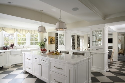 Black and white flooring, white cabinets, white counters