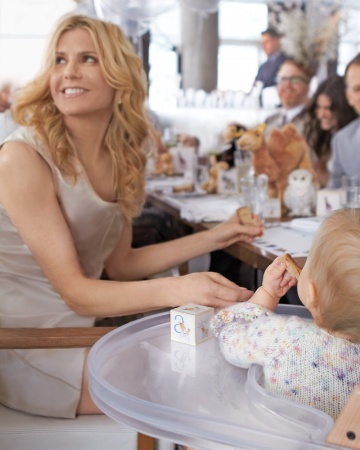 A radiant Alexis Stewart and an elusive Jude getting ready to enjoy a delicious meal prepared with such care by Jean-Georges and Cedric for Jude's First Birthday.