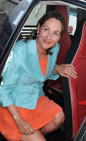 "French Socialist Party member and Poitou-Charentes' regional president, Segolene Royal, is pictured in an electric car ""Mia"" as she leaves the Europe-Ecology-Greens party (EELV) ecologists summer days in Poitiers."