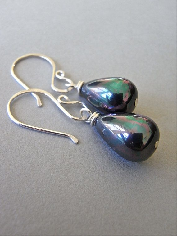 The Martinique earrings - peacock black, easy care south sea shell pearls in a stunning teardrop shape are finished with my signature ear wires in sterling.