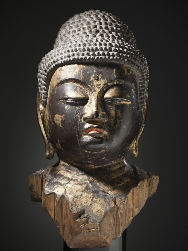 Head of a Buddha, Japan, Heian period, made of wood, lacquer, gilt, and crystal.