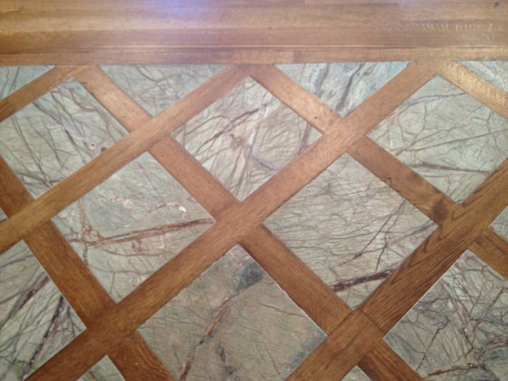 Entry floor combines tile and wood ldg designs for Floors with tile and wood combined