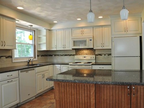 White cabinets and mountain mist silestone counters for Merillat white kitchen cabinets