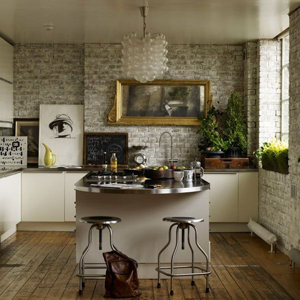 whitewashed brick + modern chandelier + old wood floors + stainless countertops + plants via coco+kelley