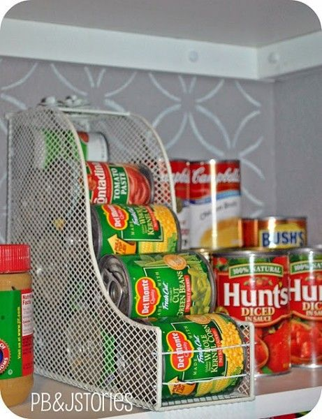 Store smaller cans of food in the pantry by turning a magazine holder on its side. Place bobby pins through the end to stop cans from rolling out.