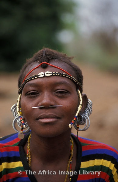 Africa | Bedik woman with porcupine coil through her nose, Iwol, Bedik village, Bassari country, Senegal | © Ariadne Van Zandbergen