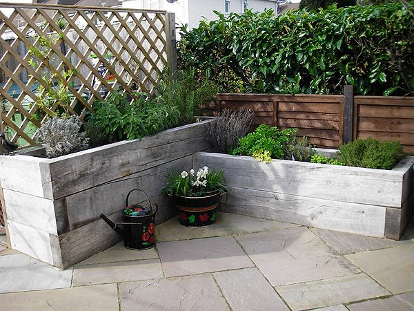 Silver wood sleeper raised bed little house pinterest for Small rear garden ideas