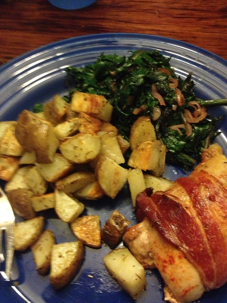 Bacon-wrapped chicken thighs, roasted herbed new potatoes, and ...