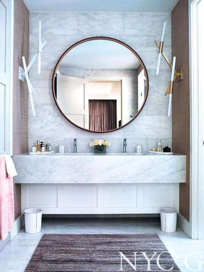 Mirror hanging above alabaster vanity in the master bathroom | New York Cottages & Gardens | May/June 2014