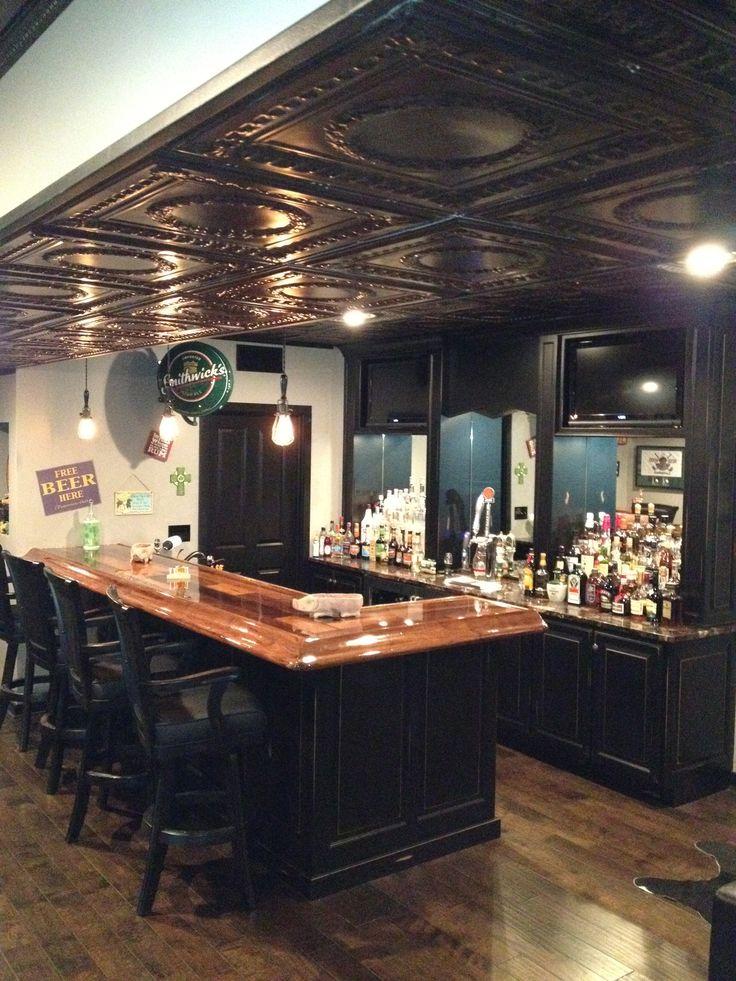 Basement pub dark wood wood counter built in tv bar for Basement bar counter