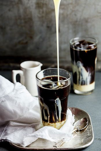 Ingredients strong black coffee sweetened condensed milk to serve coffee ice cubes Instructions Allow the coffee to come to room temperature. Fill a glass with coffee ice cubes and pour in the coffee. Pour in a generous amount of sweetened condensed milk, stir and serve.