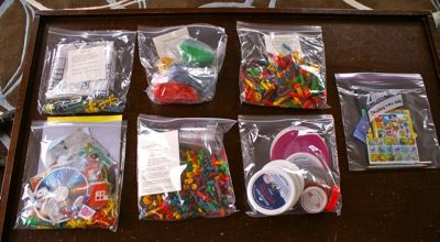 Toddler activity bags!...colored pasta beading, colored pasta sorting, mini-books and stickers, lid sorting, playdough, cut and glue collage bag, and mini-playmats with cars and things