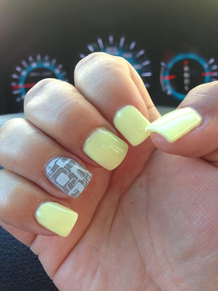 Yellow and gray gel nails with a white retro stamp yet again thanks to