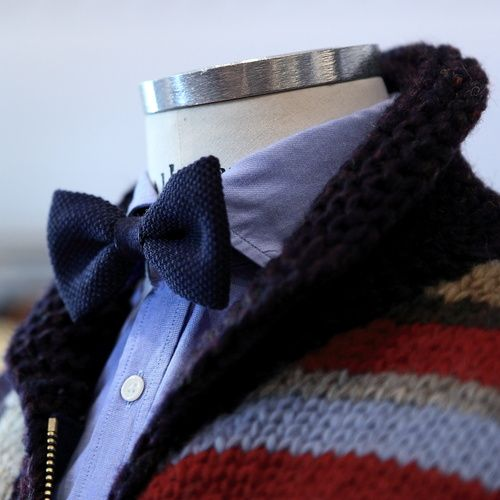 Solid, knit bowtie with a shawl collar, striped cardigan. Lander Urquijo