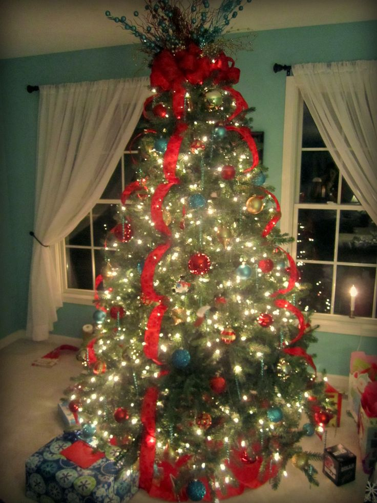 Pin by trista torres on holiday spirit pinterest for Red ribbon around tree