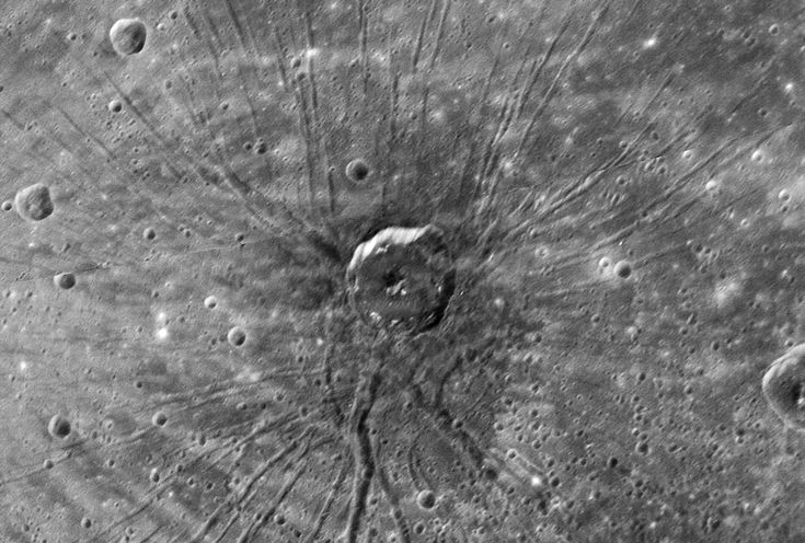 """Spider Crater in Caloris Basin on the planet Mercury.  NASA's Messenger probe took the picture of this dramatic impact crater. It looks a bit like a spider waiting in the middle of its web. Mona Evans, """"Cosmic Halloween Tour"""" http://www.bellaonline.com/articles/art52161.asp"""