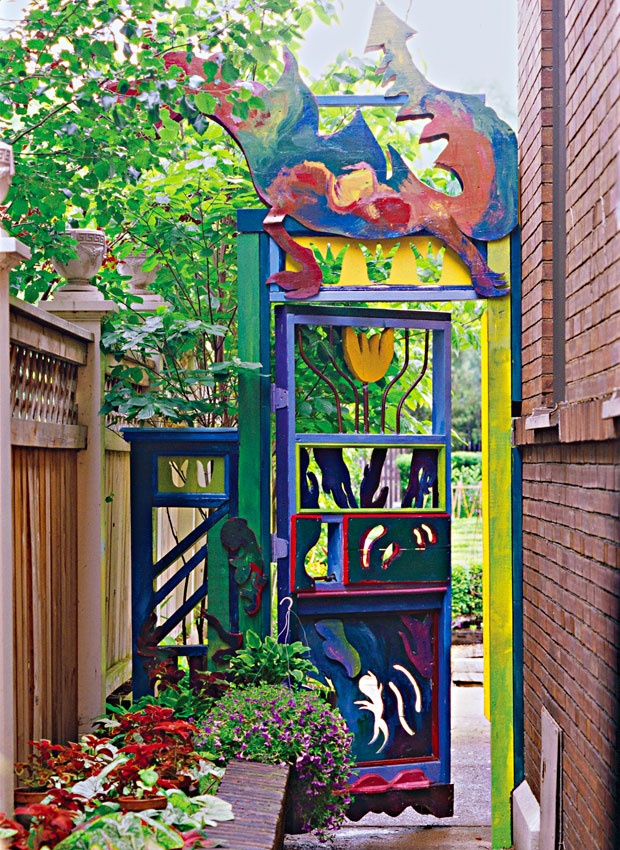 Gateway to Fun. Gates and arbors signify entrances to a garden. Why not entice visitors with the visual suggestion that they're about to enter a magical place? In this case, the brightly painted dragon sculpture and unique cutouts open a door—literally and figuratively—to the imagination. And that's really what theme gardens are all about.