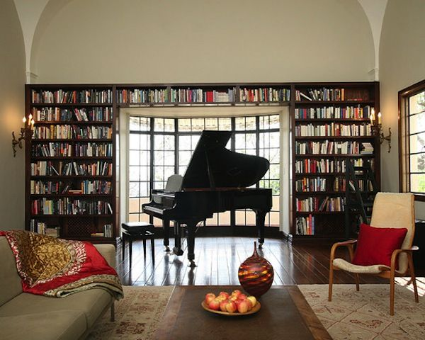 Living room or #home #library with beautiful grand #piano and comfortable seating. Really liking that #chair #design