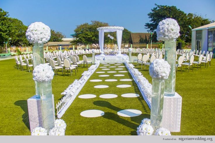 Outdoor ceremony uniquefloralcentre centerpiece pinterest for Outdoor wedding ceremony decorations pictures