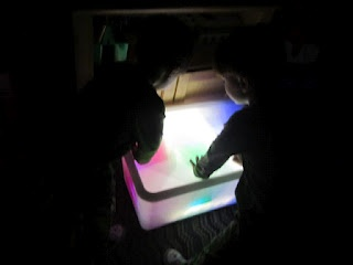 colored lighted boxes inside of light box