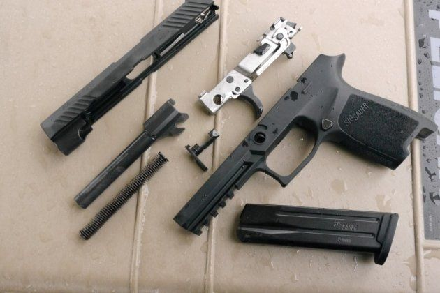 Sig p320 disassembled with interchangeable frame and slide shown. Mail ...